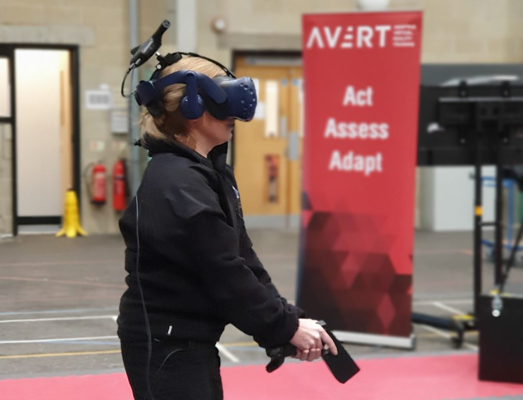 VR in action with AVRT banner in background